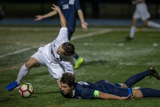 Manasquan Caeden Miller battles for the ball during second half action. Christian Brother Academy vs Manasquan Boys Soccer in Shore Conference Tournament Semifinal game in West Long Branch NJ on October 19, 2019.