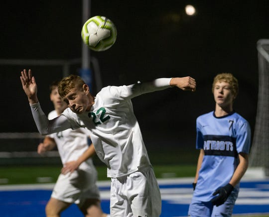 Colts Neck Brandon Carreira head the ball during first half. Colts Neck Boys Soccer vs Freehold Township in Shore Conference Tournament Semifinal game in West Long Branch NJ on October 19, 2019.