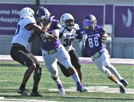 ACU receiver Kobe Clark (88) tries to evade SFA's Trenton Gordon (38) after making a catch in the second quarter. ACU beat the Lumberjacks 31-24 in two overtimes Saturday, Oct. 19, 2019, at Wildcat Stadium.