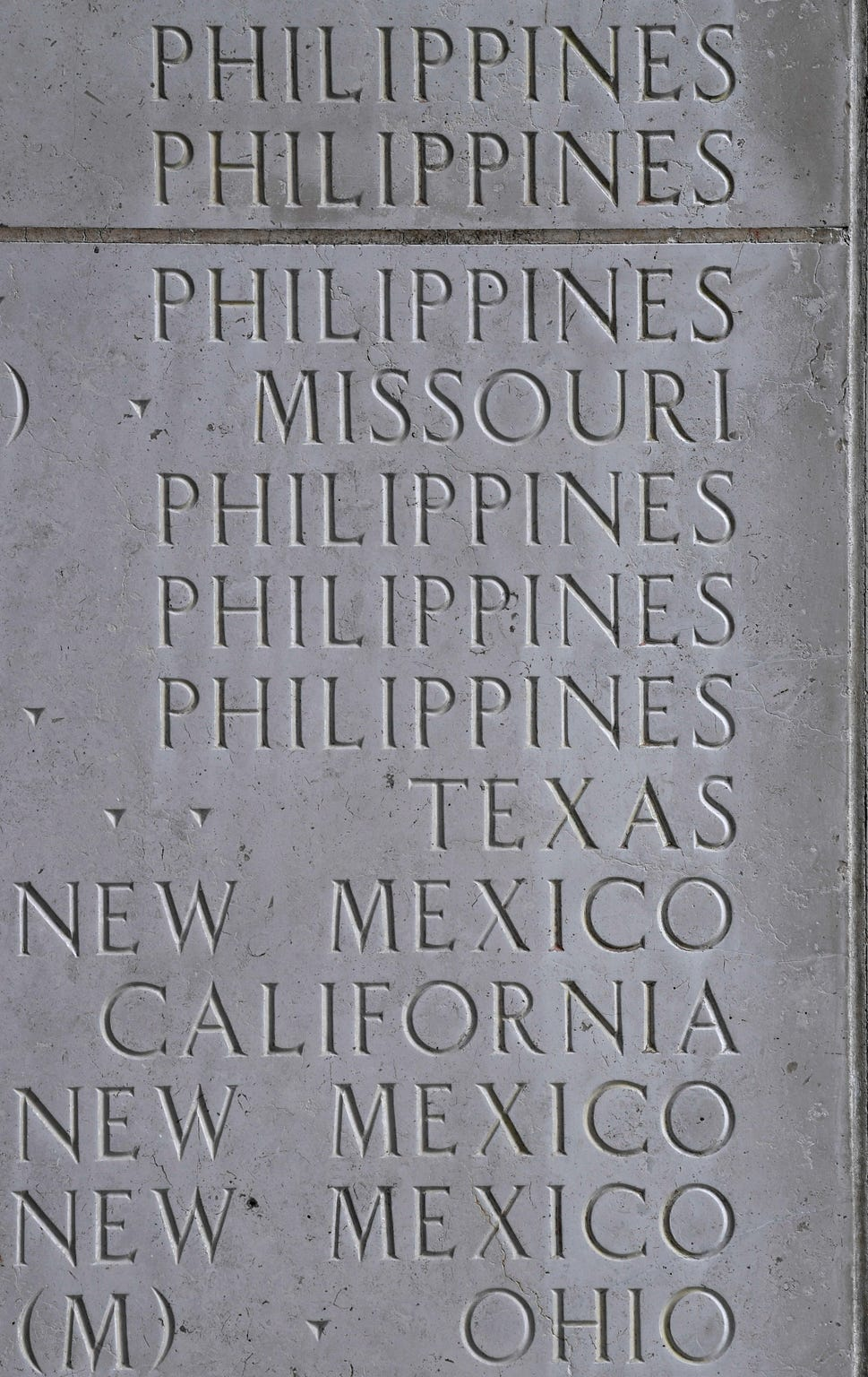 Home states are listed beside the names of the missing, including those Filipinos who served with the U.S. military during World War II. The names are carved into the Walls of the Missing at Manila American Cemetery.