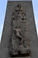 A reliefs hangs over the doorway to the chapel at the Manila American Cemetery Friday Oct. 18, 2019.