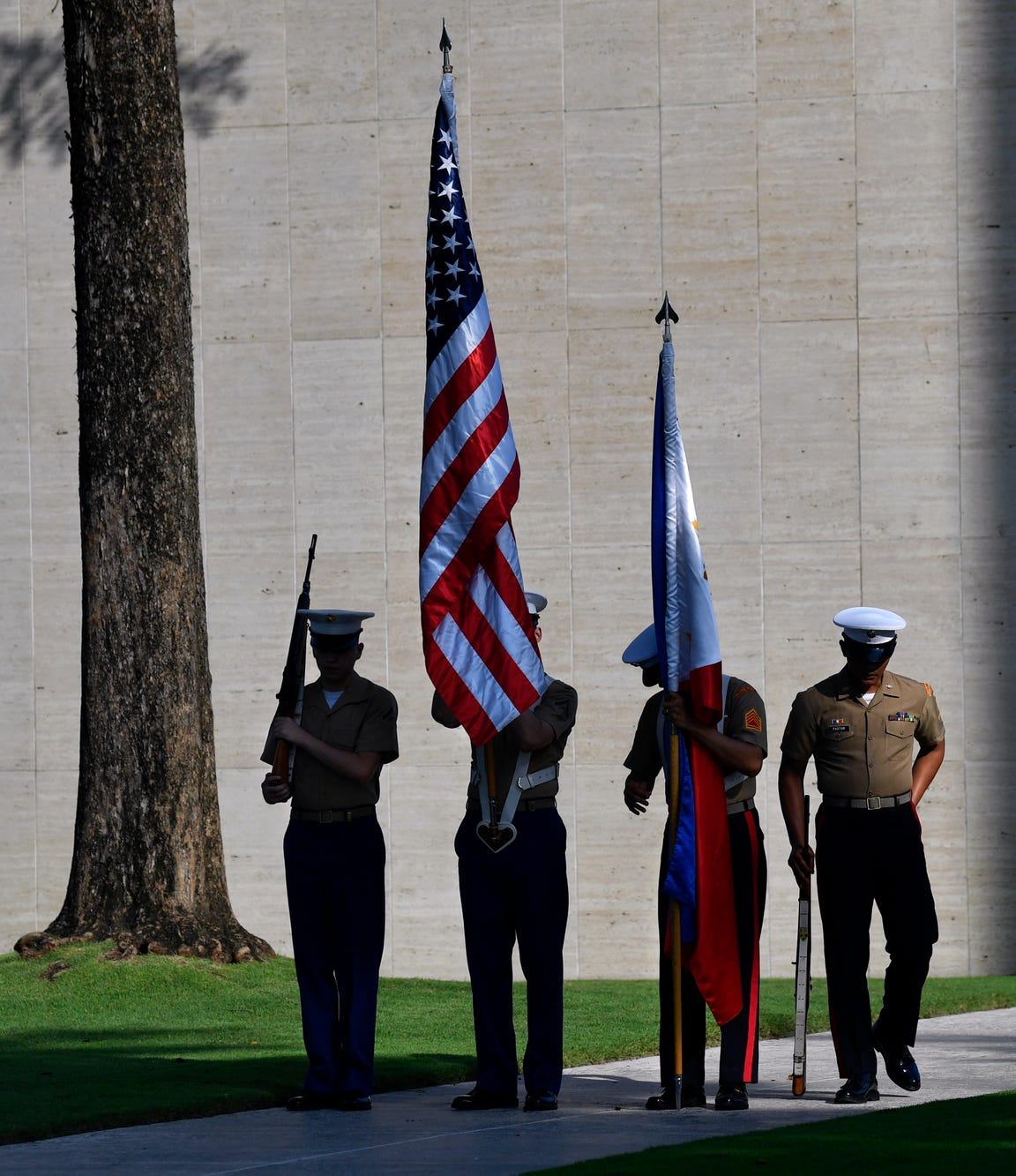 An honor guard of U.S Marines and Philippine Marines readies itself for Saturday's dedication of the new Visitor Center at Manila American Cemetery.