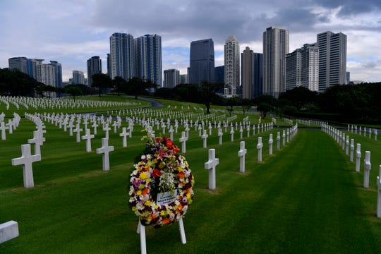 A wreath for U.S. Army soldier Willie B. Hatcher stands among other markers Saturday at the Manila American Cemetery Oct. 19, 2019. Hatcher is the namesake for VFW Post 516 in McDonough, Georgia.