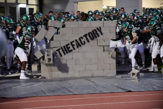 The Eastern Michigan football team enters the field at Rynearson Stadium on Saturday, Oct. 19, 2019 in Ypsilanti, Michigan.