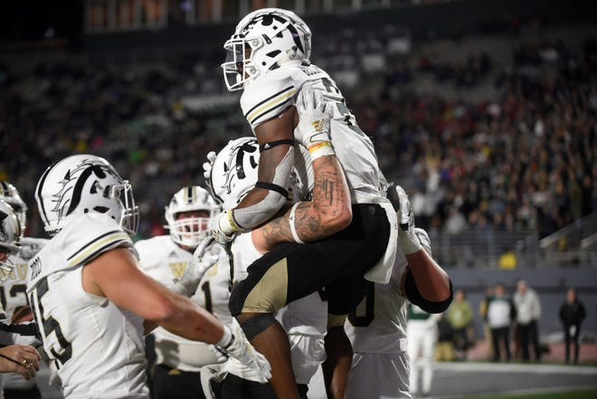 Western Michigan running back LeVante Bellamy (2) celebrates his 2-yard touchdown run on Saturday, Oct. 19, 2019 at Rynearson Stadium in Ypsilanti, Mich.