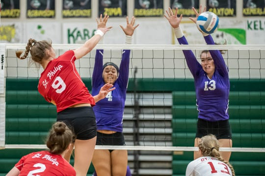 St. Phillip's Brooke Dzwik (9) goes for the kill shot while Lakeview's Faith Rankin (4) Hannah Keenan (13) go for the block and during first round action at All City Volleyball Tournament on Saturday, October 19th, 2019.