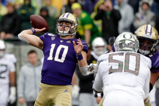 Washington quarterback Jacob Eason (10) passes against Oregon in the first half of an NCAA college football game Saturday, Oct. 19, 2019, in Seattle.