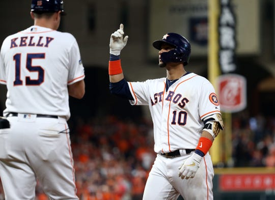 Oct 19, 2019; Houston, TX, USA; Houston Astros first baseman Yuli Gurriel (10) celebrates after hitting a single during the eighth inning against the New York Yankees in game six of the 2019 ALCS playoff baseball series at Minute Maid Park. Mandatory Credit: Troy Taormina-USA TODAY Sports