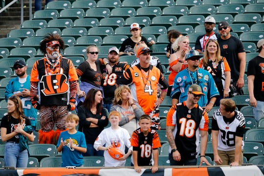Remaining Bengals fans watch the team run off after the fourth quarter of the NFL Week 7 game between the Cincinnati Bengals and the Jacksonville Jaguars at Paul Brown Stadium in downtown Cincinnati on Sunday, Oct. 20, 2019. The Bengals fell to 0-7 on the season with a 27-17 loss at home.