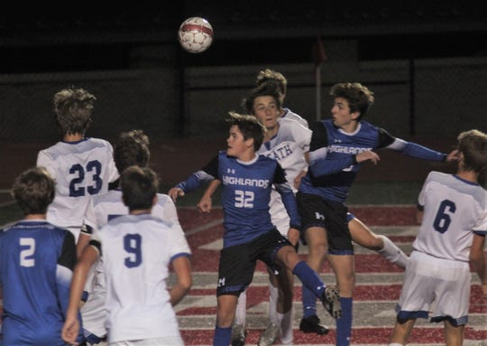 Highlands junior Max Farris, 25, heads in a goal from a throw-in by Porter Hedenberg as Highlands defeated Covington Catholic 2-2 (2-1 in penalty kicks) in the Ninth Region boys soccer championship October 19, 2019 at Dixie Heights High School, Edgewood KY.