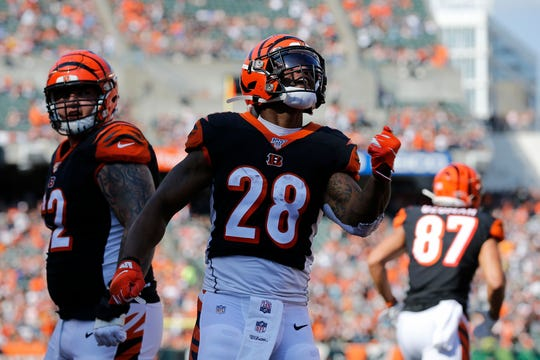 Cincinnati Bengals running back Joe Mixon (28) celebrates a touchdown reception in the second quarter of the NFL Week 7 game between the Cincinnati Bengals and the Jacksonville Jaguars at Paul Brown Stadium in downtown Cincinnati on Sunday, Oct. 20, 2019.