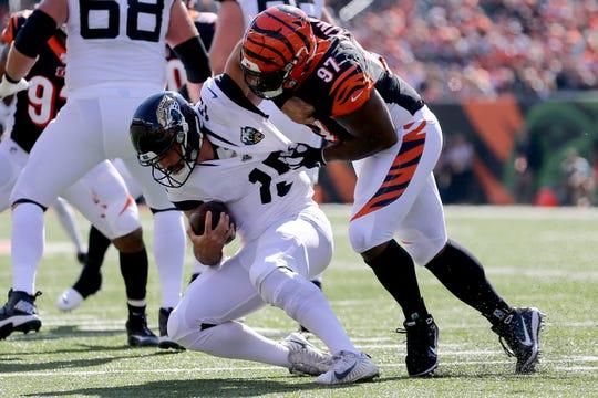 Cincinnati Bengals defensive tackle Geno Atkins (97) sacks Jacksonville Jaguars wide receiver Justin Blackmon (14) in the first quarter during a Week 7 NFL football game, Sunday, Oct. 20, 2019, at Paul Brown Stadium in Cincinnati.