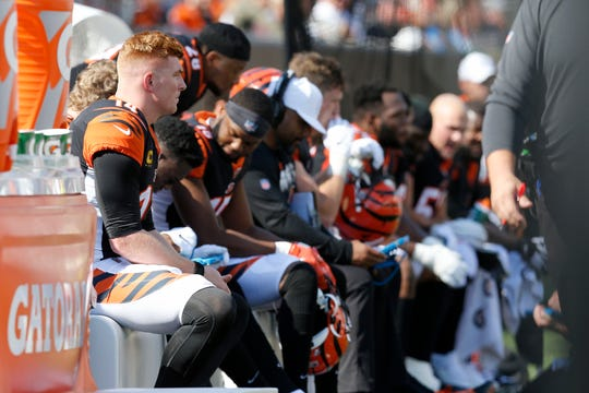 Cincinnati Bengals quarterback Andy Dalton (14) waits on the bench between drives in the second quarter of the NFL Week 7 game between the Cincinnati Bengals and the Jacksonville Jaguars at Paul Brown Stadium in downtown Cincinnati on Sunday, Oct. 20, 2019.