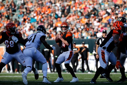 Cincinnati Bengals quarterback Andy Dalton (14) drops back to throw in the fourth quarter of the NFL Week 7 game between the Cincinnati Bengals and the Jacksonville Jaguars at Paul Brown Stadium in downtown Cincinnati on Sunday, Oct. 20, 2019. The Bengals fell to 0-7 on the season with a 27-17 loss at home.