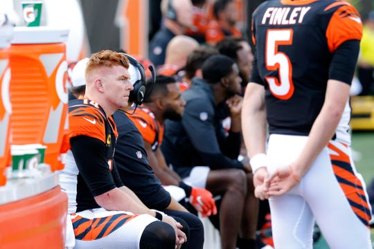 Cincinnati Bengals quarterback Andy Dalton (14) looks on from the bench in the fourth quarter of the NFL Week 7 game between the Cincinnati Bengals and the Jacksonville Jaguars at Paul Brown Stadium in downtown Cincinnati on Sunday, Oct. 20, 2019. The Bengals fell to 0-7 on the season with a 27-17 loss at home.
