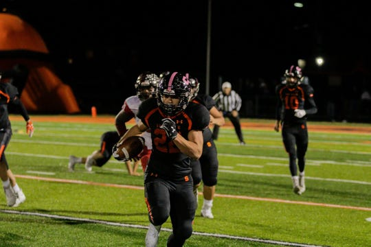 Somerville's Cookie Desderio makes a run during Friday night's victory over Rahway