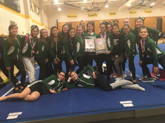 East Brunswick poses after winning the 2019 GMC Gymnastics Championship.
