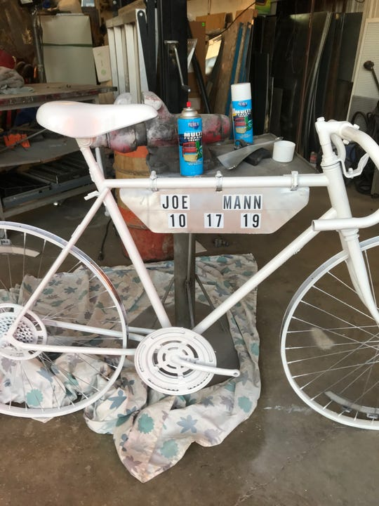 "Russel Price made a ""ghost bike"" for his friend of over 30 years,  Joe Mann, who was fatally hit while biking Thursday. The completely white was place where the accident took place to remind drivers to pay attention."