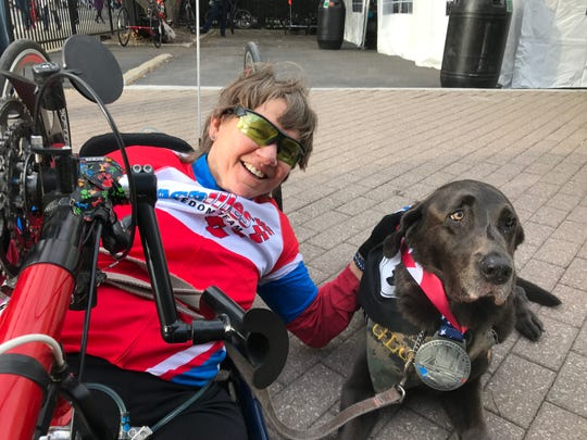 Holly Koester who flipped in a jeep in 1990 while serving in the U.S. Army, relaxes after placing second among women in the Disabilities Division of Sunday's Detroit Free Press/TCF Bank marathon.