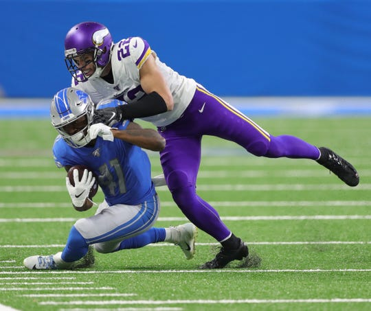 Detroit Lions running back J.D. McKissic makes a catch against Minnesota Vikings safety Harrison Smith during the first half Sunday, Oct. 20, 2019 at Ford Field.