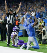 Marvin Jones after catching an 11-yard score during the first half against Minnesota.
