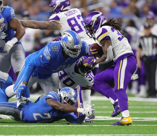 Lions defensive tackle A'Shawn Robinson (91) tries to tackle Vikings running back Dalvin Cook during the first half Sunday.