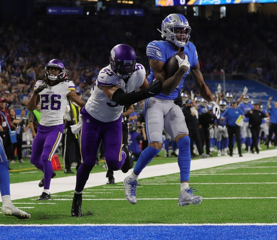 Marvin Jones catches a touchdown pass in the first half.