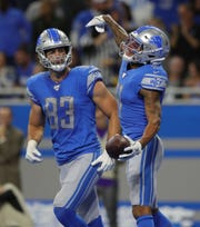 Detroit Lions receiver Marvin Jones (11) celebrates his second touchdown against the Minnesota Vikings with tight end Jesse James during the first half Sunday, Oct. 20, 2019 at Ford Field.