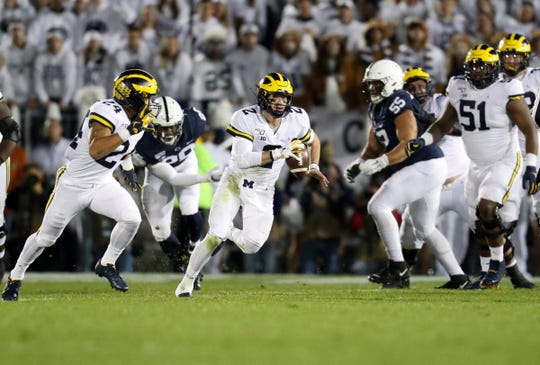 Michigan quarterback Shea Patterson runs with the ball during the first quarter against Penn State at Beaver Stadium, Oct. 19, 2019.