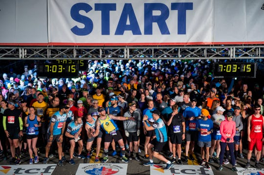 Runners take a selfie on the starting line during the 42nd Annual Detroit Free Press/TCF Bank Marathon in Detroit on Sunday, Oct. 20, 2019.