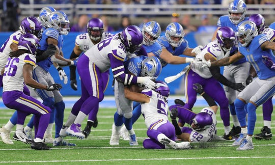 Detroit Lions running back Kerryon Johnson is tackled by Minnesota Vikings defenders during the first half Sunday, Oct. 20, 2019 at Ford Field.