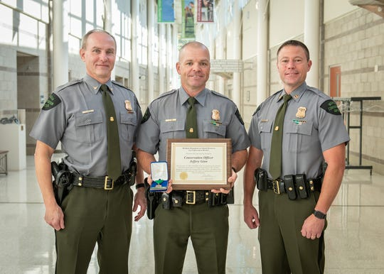 DNR Law Enforcement Division Chief Gary Hagler (left), poses with Conservation Officer Jeff Ginn and Capt. David Malloch.