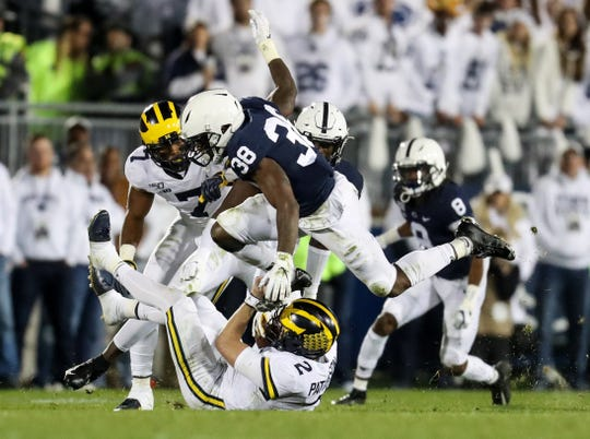 Michigan quarterback Shea Patterson (2) slides during the fourth quarter against Penn State at Beaver Stadium, Oct. 19, 2019.