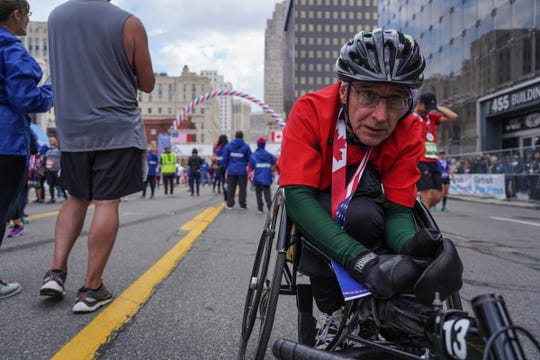 Andrew Barnhart of Reading, MI talks with a reporter after crossing the finish line during the disabilities division race of the 42nd Detroit Free Press/TCF Bank Marathon in downtown Detroit on Sunday, October 20, 2019.