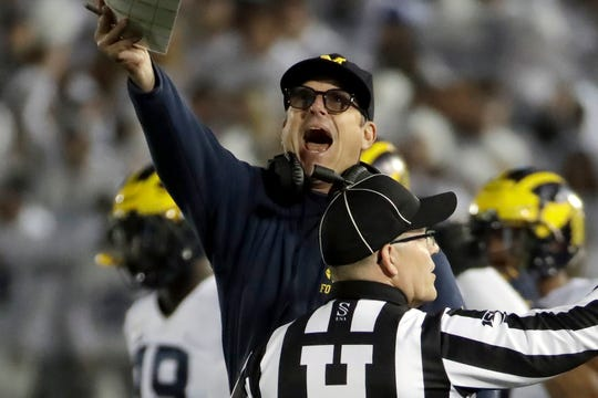 Michigan coach Jim Harbaugh disputes first-half call against Penn State at State College, Pa., Oct. 19, 2019.