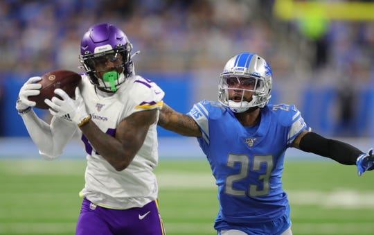 Darius Slay gives up a long pass to Vikings receiver Stefon Diggs during the first half.