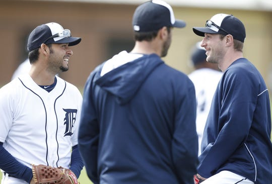 Detroit Tigers pitchers left to right: Anibal Sanchez, Justin Verlander and Max Scherzer talk at spring training in Lakeland, Fla. on Feb. 14, 2014.