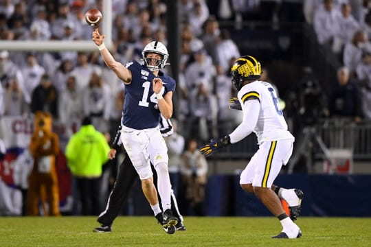 Penn State quarterback Sean Clifford passes as Michigan linebacker Josh Uche defends during the second quarter at Beaver Stadium, Oct. 19, 2019.