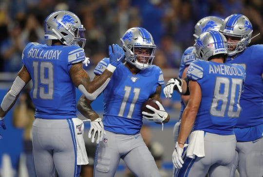 Marvin Jones (11) celebrates his third TD during the first half Sunday.