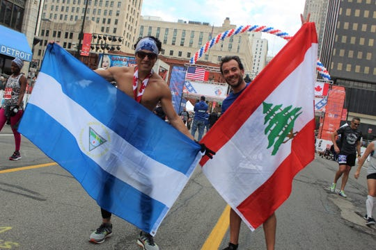 Danys Novoa, left, from Nicaragua, and Rami Haddad, from Lebanon, represent their homelands at the 2019 Detroit Free Press/TCF Bank Marathon on Sunday, Oct. 20, 2019.