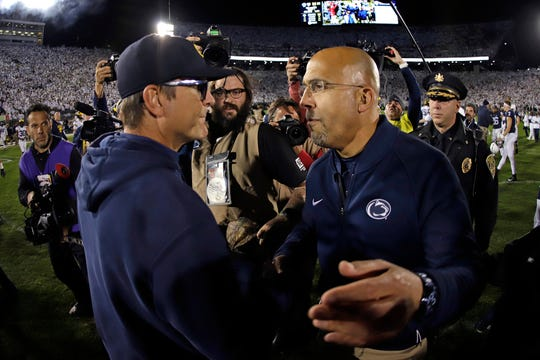 Michigan coach Jim Harbaugh, left, and Penn State coach James Franklin meet following the Wolverines' 28-21 loss at Beaver Stadium, Oct. 19, 2019.