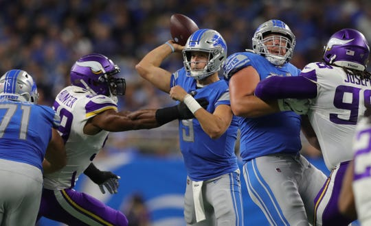 Lions quarterback Matthew Stafford passes during the first half on Sunday, Oct. 20, 2019, at Ford Field.