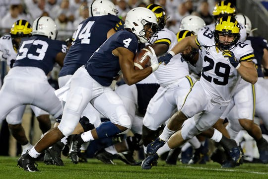 Penn State running back Journey Brown runs for a first down during the first half against Michigan at Beaver Stadium, Saturday, Oct. 19, 2019.