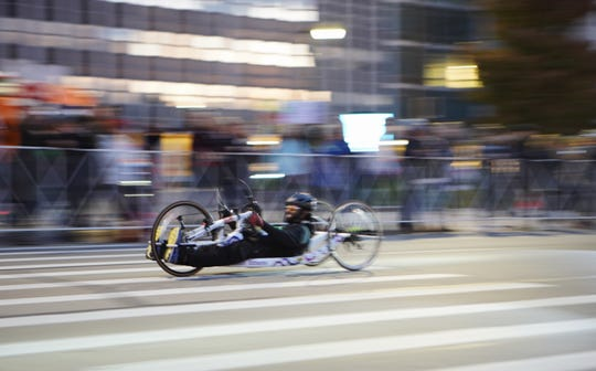 Sallah Mohamed cycles past mile 13 during the 42nd Annual Detroit Free Press/TCF Bank Marathon in Detroit on Sunday, Oct. 20, 2019. Planet Fitness gave him a brand new handcycle for his first marathon.