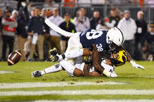 Michigan receiver Ronnie Bell drops the potential tying touchdown in the end zone on fourth down against Penn State safety Lamont Wade in the fourth quarter at Beaver Stadium, Oct. 19, 2019.