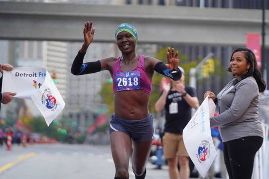 Joan Massah crosses the finish line in first place for the women in the full marathon during the 42nd Detroit Free Press/TCF Bank Marathon in downtown Detroit on Sunday, October 20, 2019.
