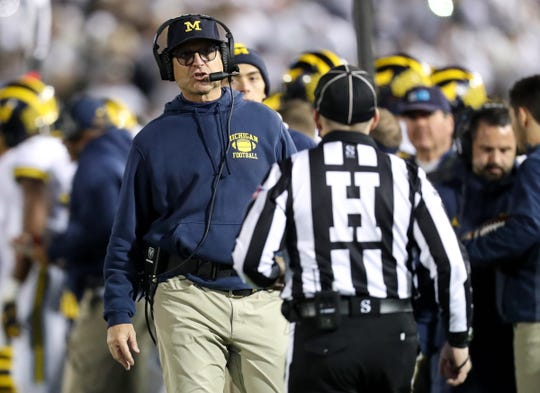 Michigan coach Jim Harbaugh walks on the sideline during the second quarter against Penn State at Beaver Stadium, Oct. 19, 2019.