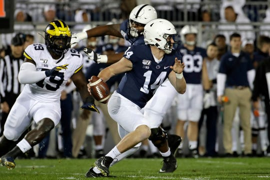 Penn State quarterback Sean Clifford runs for a first down against Michigan.