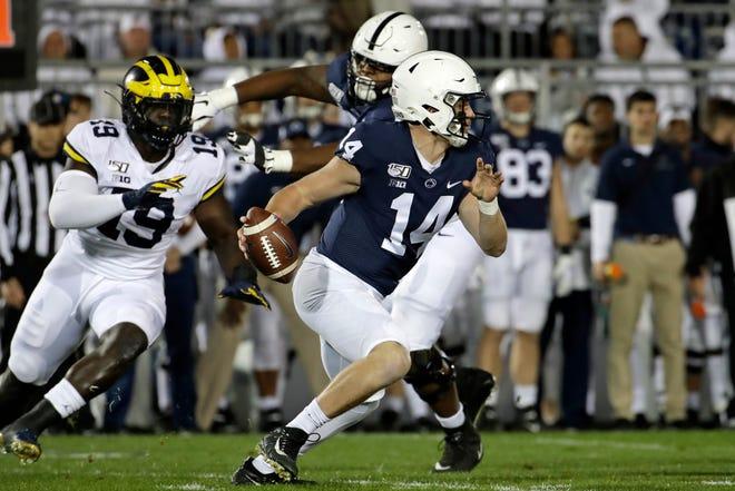 Penn State quarterback Sean Clifford runs for a first down against Michigan.