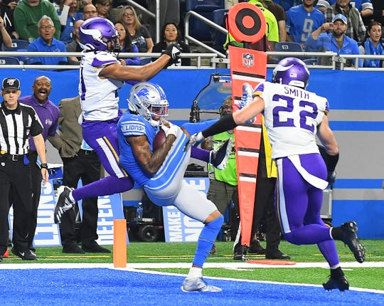 Marvin Jones hauls in the third of his four touchdown receptions in front of Vikings' Mike Hughes.